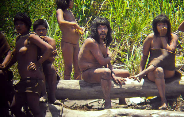Uncontacted Mashco-Piro Indians on a riverbank near the Manú National Park. 2011. © Jean-Paul Van Belle